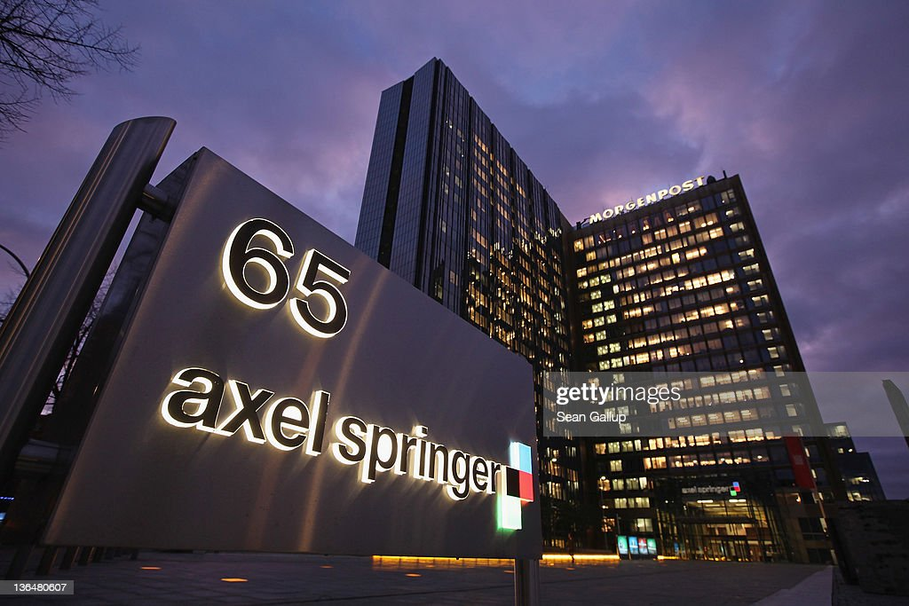 The corporate headquarters of Axel Springer Verlag publishing house, which includes Germany's biggest tabloid newspaper, Bild Zeitung, stands illuminated on January 6, 2011 in Berlin, Germany. Bild Zeitung Editor-in-Chief Kai Diekmann and German President Chistian Wulff are locked into a war of words over a message Wulff left on Diekmann's mobile phone in which he reportedly demanded that Bild not publish a compromising story about Wulff's personal financial conduct while governor of Lower Saxony. In a recent television interview Wulff claimed he only asked Diekmann to postpone publication of the story by a day.