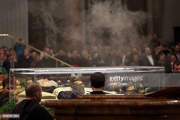 The corpse and relics of Padre Pio are carried by frears as they are displayed in St Peter's Basilica for veneration by the faithful in connection...