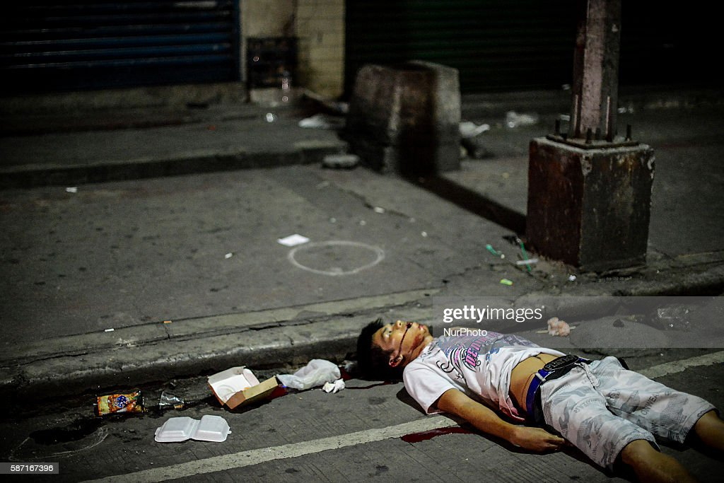 Image depicts graphic content The corpse of a suspected drug pusher lies on a street after he was shot dead by unidentified gunmen in Caloocan north...
