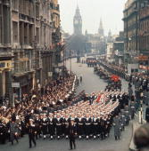 The cortege at the state funeral of Sir Winston Churchill makes its way down Whitehall London with Big Ben in the background 30th January 1965