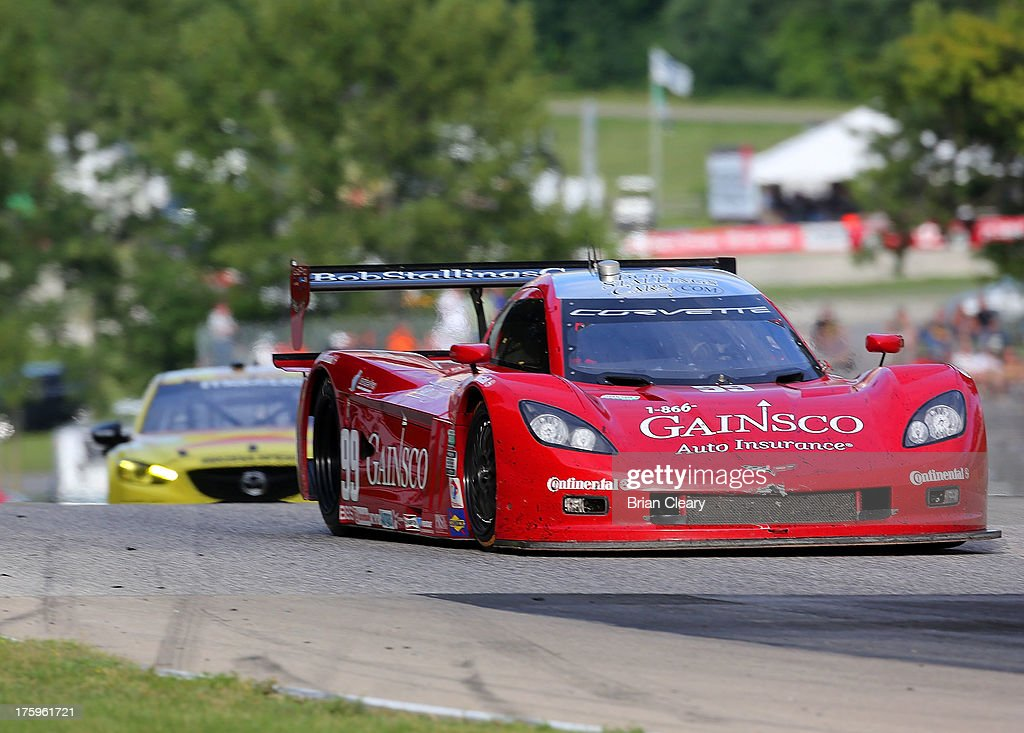 The #99 Corvette DP of Alex Gurney and Jon Fogarty leads another car during the VisitFlorida.com Sports Car 250 at Road America on August 10, 2013 in Elkhart Lake, Wisconsin.