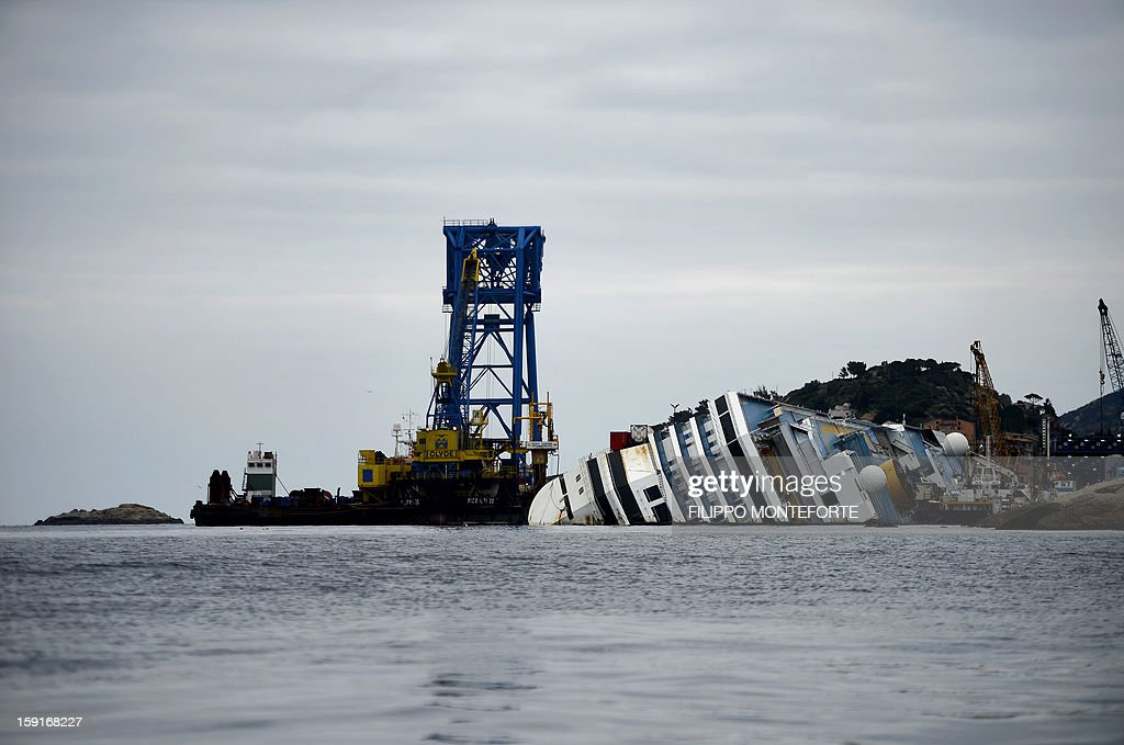 The Costa Concordia cruise ship lays aground near the port on January 9, 2013 on the Italian island of Giglio