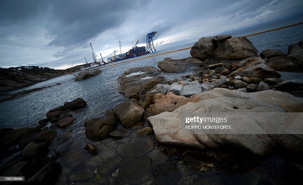 The Costa Concordia cruise ship lays aground near the port on January 10, 2013 on the Italian island of Giglio. A year on from the Costa Concordia tragedy in which 32 people lost their lives, the giant cruise ship still lies keeled over on an Italian island and its captain Francesco Schettino has become a global figure of mockery.
