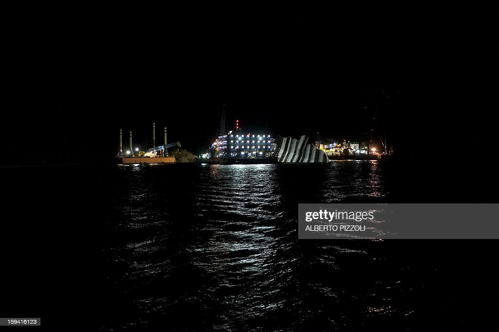 The Costa Concordia cruise ship lays aground on January 13, 2013 on the Italian island of Giglio. Survivors, grieving relatives and locals on the island of Giglio gathered on January 13 to mark the first anniversary of the Costa Concordia cruise ship disaster, which claimed 32 victims.