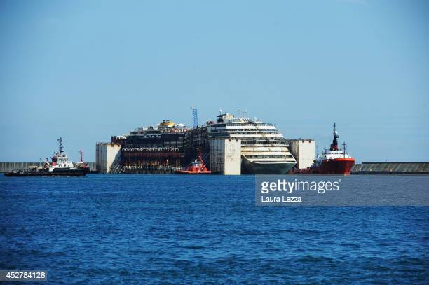 The Costa Concordia is seen inside the port of PraVoltri while tugs are completing the maneuvers on July 27 2014 in Genoa Italy The Costa Concordia...