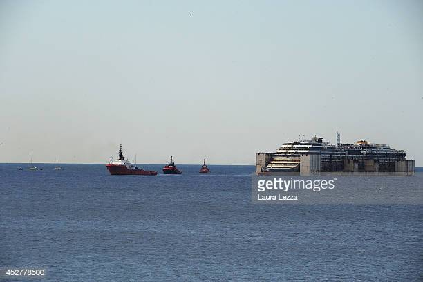 The Costa Concordia is seen near the entrance of the port of PraVoltri on July 27 2014 in Genoa Italy The Costa Concordia ship after 4 days of...