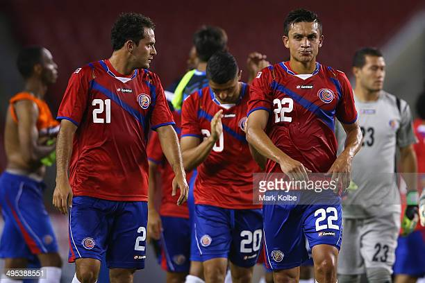 The Costa Rica team looks dejected after defeat during the International Friendly Match between Japan and Costa Rica at Raymond James Stadium on June...