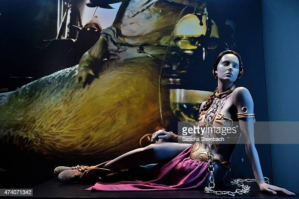 The costume worn by Carrie Fisher as Princess Leia while imprisoned by Jabba the Hutt is seen during the 'Star Wars Identities' Exhibtion Press...