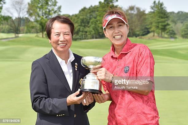 The counselor of LPGA Japan Hisako Higuchi and Nobuko Kizawa of Japan pose with the trophy after winning the LPGA Legends Championship Izak Cup at...