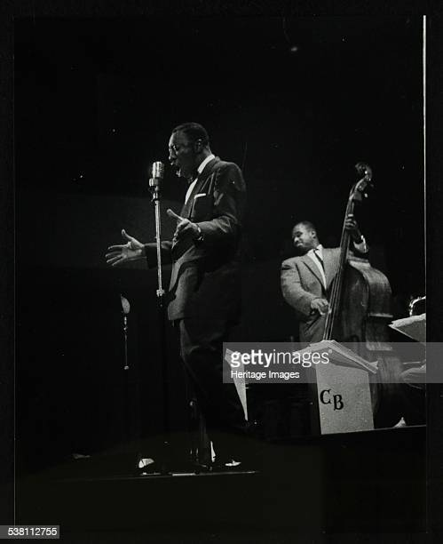 The Count Basie Orchestra in concert at Colston Hall Bristol 1957 Joe Williams on vocals and Eddie Jones on double bass Artist Denis Williams