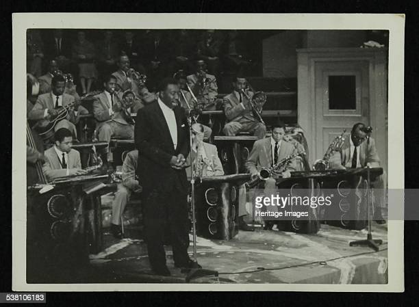 The Count Basie Orchestra in concert c1950s Joe Williams on vocals Artist Denis Williams
