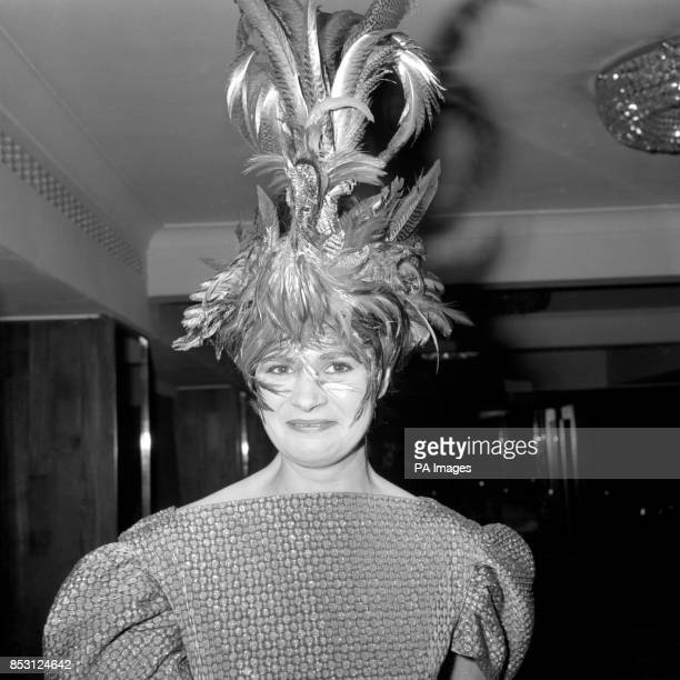 The Countess of Harewood wearing a headdress from 'The Golden Cockerel' designed by acclaimed film and TV designer Alan Sievewright at the Opera Ball...