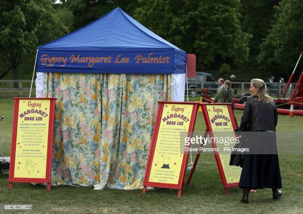 The Countess of Wessex looks on as Autumn Phillips has her fortune told during the Royal Windsor Horse Show which is held in the grounds of Windsor...