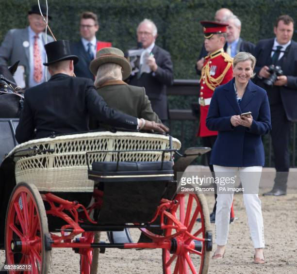 The Countess of Wessex prepares to take a photograph of her daughter Lady Louise Windsor at the Champagne LaurentPerrier Meet of the British Driving...