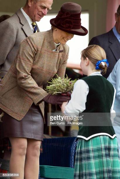 The Countess of Wessex reaches down as Eve Blackett eleven presents her with a posie at the Braemar Games in Royal Deeside Scotland The Braemar...