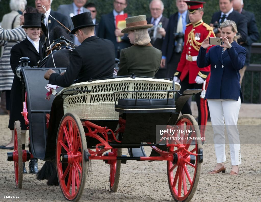 The Countess of Wessex takes a photograph of her daughter Lady Louise Windsor at the Champagne Laurent-Perrier Meet of the British Driving Society at the Royal Windsor Horse Show, which is held in the grounds of Windsor Castle in Berkshire.