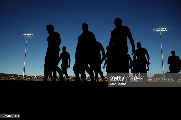 The Country team leave the field after during the warmup beforeup ahead of the 2017 City versus Country Origin match at Glen Willow Sports Ground on...