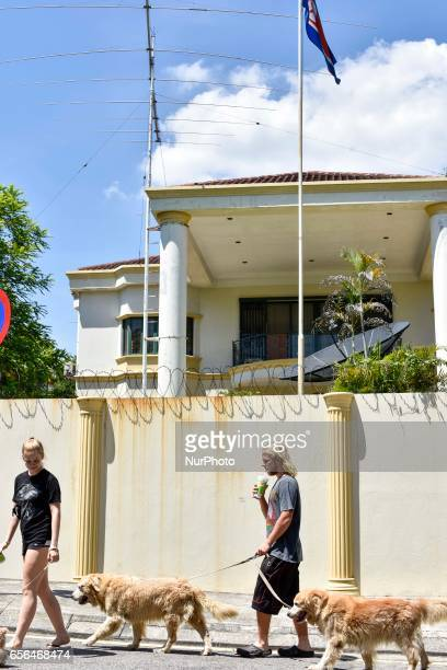 The couple are walking with their dogs in front of the North Korean Embassy on March 22 2017 in Kuala Lumpur Malaysia Malaysia has used DNA sample...