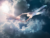 The couple made of clouds are flying in the sky