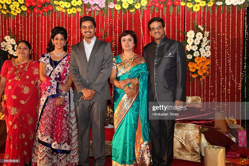 The couple Swati Thorat and Ameya Yeravdekar, grandson of educationist Dr SB Mujumdar pose with their families during their wedding reception at Delhi Gymkhana on March 22, 2013 in New Delhi, India.