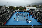 The court is dried during a rain delay on day four of the 2015 Hobart International at Domain Tennis Centre on January 14 2015 in Hobart Australia