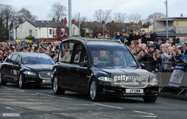 The courtage carrying the coffin of Sir Tom Finney as it passes by Deepdale Stadium