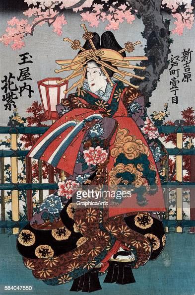 The courtesan Hanamurasaki from Tamaya house on Edo Street the left panel from an Edo Period Japanese ukiyoe triptych 18481868 Series title in...