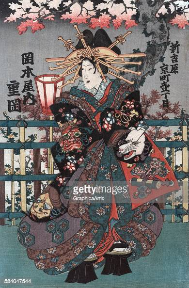 The courtesan Shigeoka from Okamotoya house on Kyo Street the right panel from an Edo Period Japanese ukiyoe triptych 18481868 Series title in...