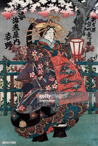 The courtesan Sugatano from Ebiya house on Kyo Street the center panel from an Edo Period Japanese ukiyoe triptych 18481868 Series title in Japanese...