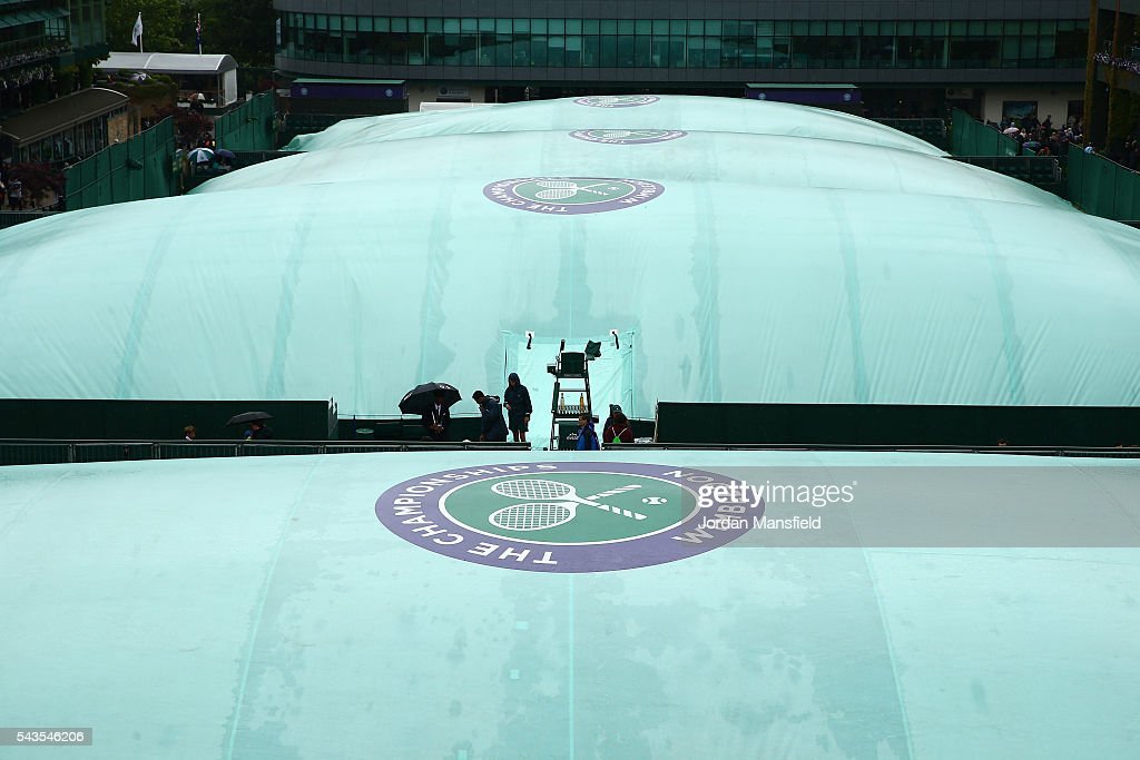 The courts are covered due to a rain delay on day three of the Wimbledon Lawn Tennis Championships at the All England Lawn Tennis and Croquet Club on June 29, 2016 in London, England.