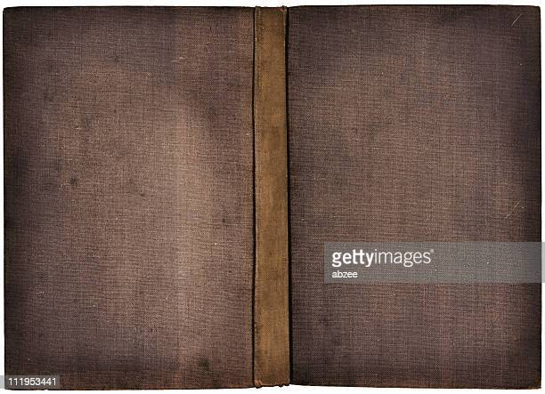 The cover of an old book in grey