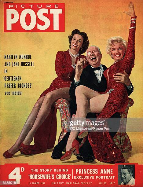 The cover of Picture Post magazine features a portrait of American actresses Jane Russell and Marilyn Monroe in matching gowns designed by Travilla...