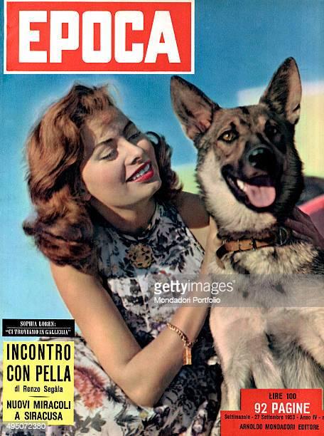 The cover of the weekly magazine Epoca with Italian actress Sophia Loren caressing a German shepherd Italy 1953