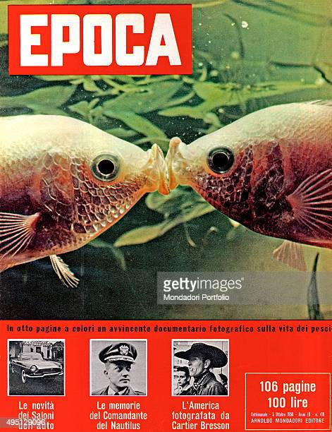 The cover of the weekly magazine Epoca with two small fishes kissing each other image from a documentary about their lives Italy 1958
