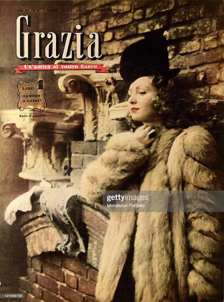 The cover of the women's magazine Grazia showing a young woman leaning on a wall. 1930s