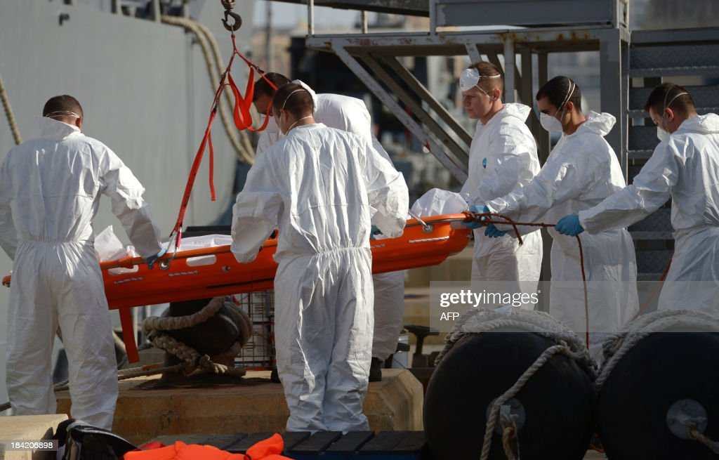 The covered bodies of two children are brought ashore at Hay Wharf in Valletta after being recovered by a patrol boat of the Armed forces of Malta on October 12, 2013, a day after a boat carrying migrants sank. More than 140 survivors, plucked from the sea after their overloaded boat sank in the latest deadly migrant tragedy to hit the Mediterranean, arrived in Malta. The sinking killed more than 30, most of them women and children, when the boat packed with people desperate to reach European shores went down off Malta near the Italian island of Lampedusa, according to officials.