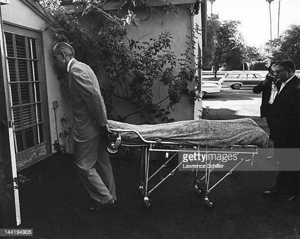 APPLY The covered body of American actress Marilyn Monroe is wheeled into Westwood Village Memorial Park Cemetery Los Angeles California August 5...