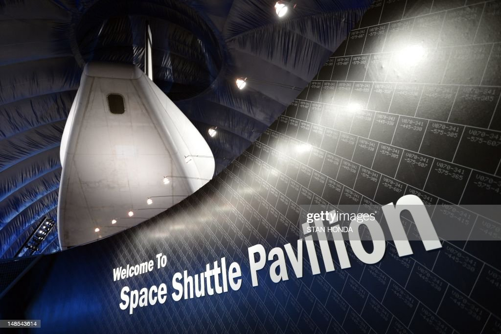 The covered tail section of the Space Shuttle Enterprise on display at the Intrepid Sea, Air & Space Museum's Space Shuttle Pavilion during a press preview July 18, 2012 in New York. The exhibit will officially open to the public July 19. AFP PHOTO/Stan HONDA