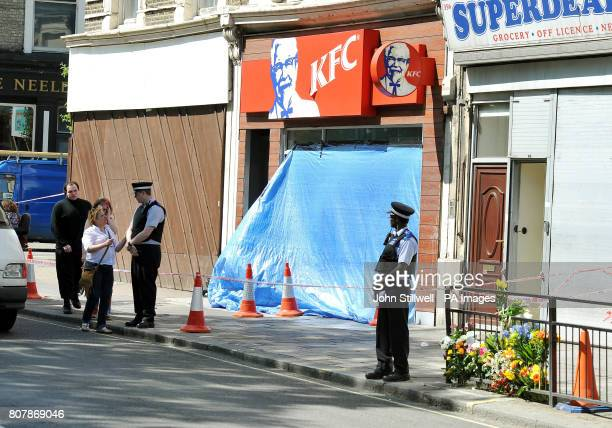 The covered up front of a KFC fast food outlet after a man was shot outside the shop in Harrow Road west London early this morning