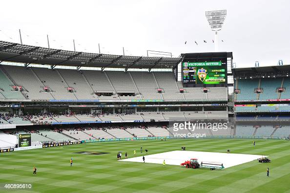 The covers are put on the pitch during a rain delay during day five of the Third Test match between Australia and India at Melbourne Cricket Ground...