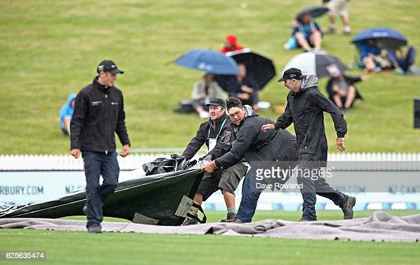 The covers go on as rain stops play just before lunch on day one of the Second Test match between New Zealand and Pakistan at Seddon Park on November...