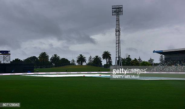 The covers remain on the field as rain falls on McLean Park delaying the start of the second oneday international cricket match between New Zealand...
