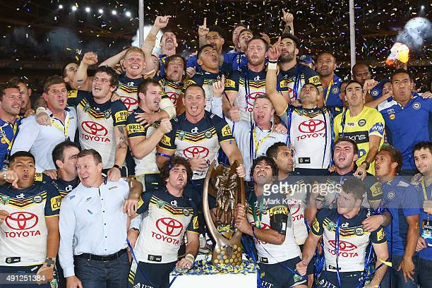 The Cowboys pose with the Premiership trophy as they celebrate victory during the 2015 NRL Grand Final match between the Brisbane Broncos and the...