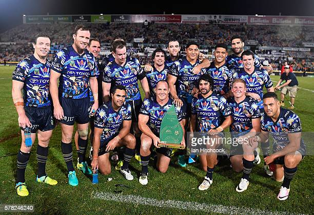 The Cowboys pose with the 'Reconciliation Cup' after wining the round 20 NRL match between the North Queensland Cowboys and the Canterbury Bulldogs...