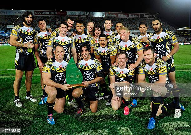 The Cowboys pose with the reconciliation trophy after winning the round nine NRL match between the North Queensland Cowboys and the Canterbury...