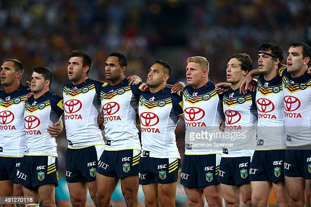 The Cowboys stand and sing the National Anthem before the 2015 NRL Grand Final match between the Brisbane Broncos and the North Queensland Cowboys at...