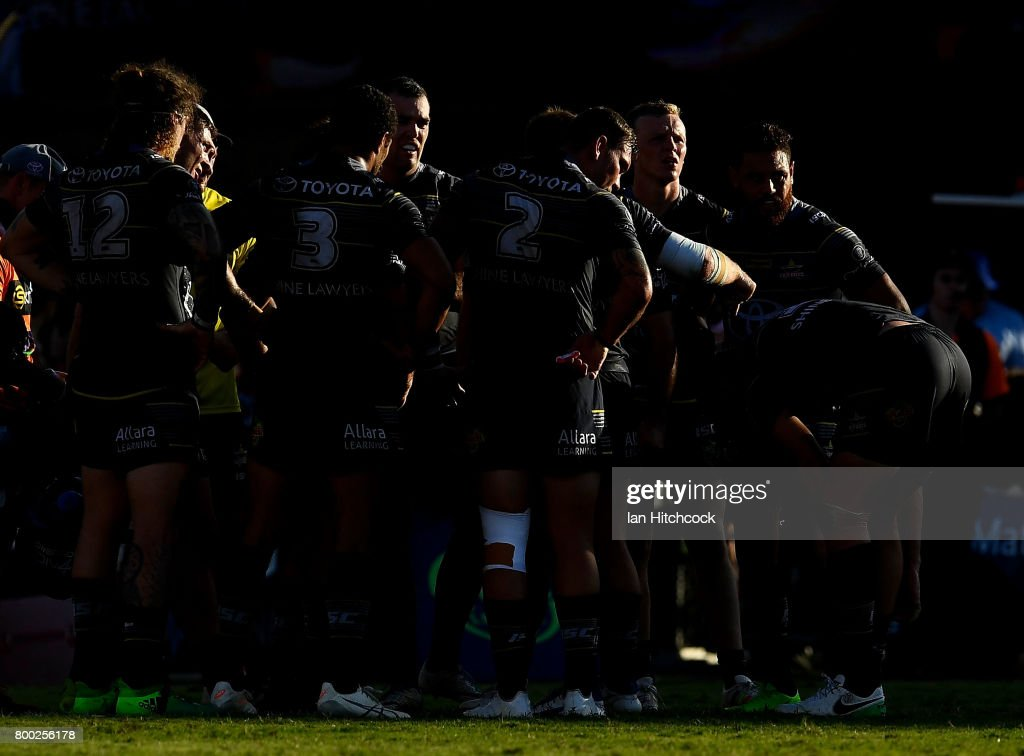The Cowboys stand together waiting for a conversion attempt during the round 16 NRL match between the North Queensland Cowboys and the Penrith Panthers at 1300SMILES Stadium on June 24, 2017 in Townsville, Australia.
