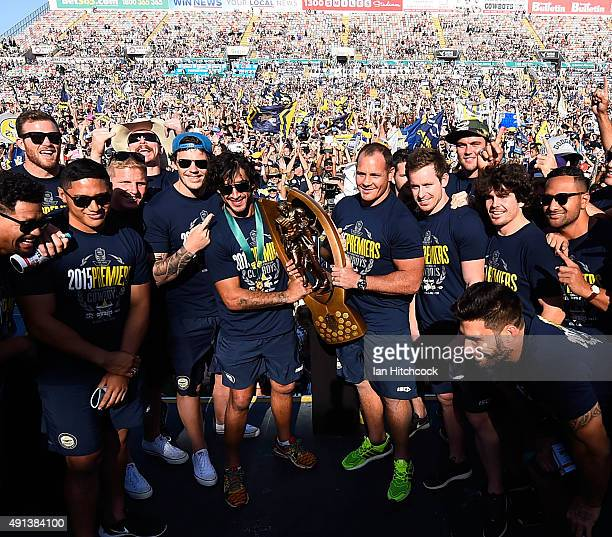 The Cowboys team hold aloft the NRL trophy on stage during the North Queensland Cowboys NRL Grand Final fan day at 1300 Smiles Stadium on October 5...