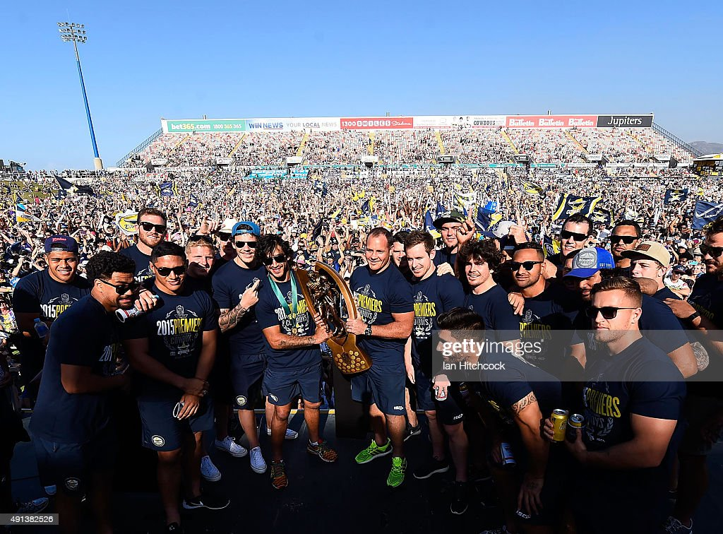 The Cowboys team pose with the NRL trophy on stage during the North Queensland Cowboys NRL Grand Final fan day at 1300 Smiles Stadium on October 5, 2015 in Townsville, Australia.