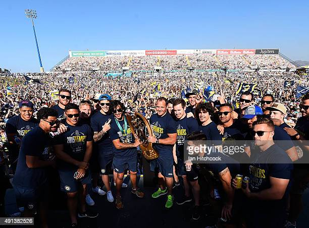 The Cowboys team pose with the NRL trophy on stage during the North Queensland Cowboys NRL Grand Final fan day at 1300 Smiles Stadium on October 5...